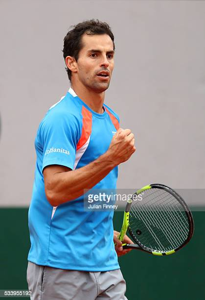 Santiago Giraldo of Columbia reacts during the Men's Singles first round match against PaulHenri Mathieu of France on day three of the 2016 French...