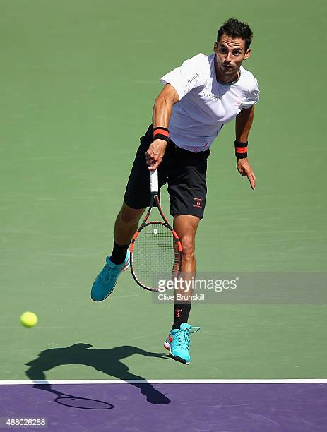 Santiago Giraldo of Columbia serves against Andy Murray of Great Britain in their third round match during the Miami Open Presented by Itau at...