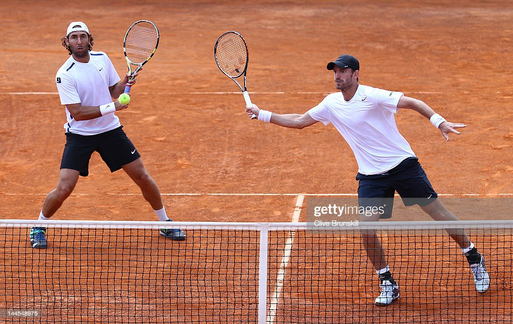 Santiago Gonzalez of Mexico and <a gi-track='captionPersonalityLinkClicked' href=/galleries/search?phrase=Christopher+Kas&family=editorial&specificpeople=987913 ng-click='$event.stopPropagation()'>Christopher Kas</a> of Germany in action against Bob Bryan and Mike Bryan of the USA in their second round doubles match during day five of the Internazionali BNL d'Italia 2012 at the Foro Italico Tennis Centre on May 16, 2012 in Rome, Italy.