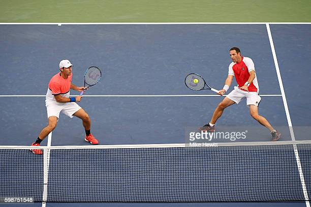 Santiago Gonzalez of Mexico and Jonathan Erlich of Israel in action against Bob Bryan and Mike Bryan of the United States during their second round...