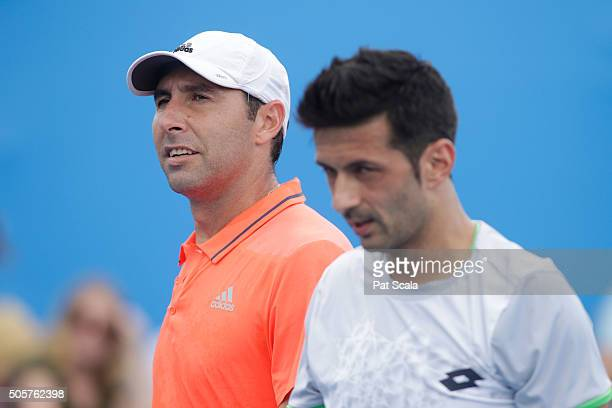 Santiago Gonzalez of Mexico and Julian Knowle of Austria talk tactics in their first round match against Thomaz Bellucci of Brazil and Marcelo...