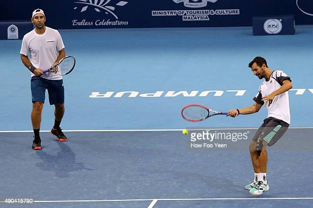 Santiago Gonzalez of Mexico and Philipp Petzschner of Germany competes against Mohd Assri Merzuki and Syed Mohd Agil Syed Naguib of Malaysia during...