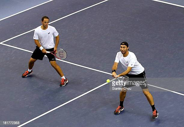 Santiago Gonzalez of Mexico and Scott Lipsky of USA in action against Julian Knowle and Jurgen Melzer of Austria during day three of the 2013...