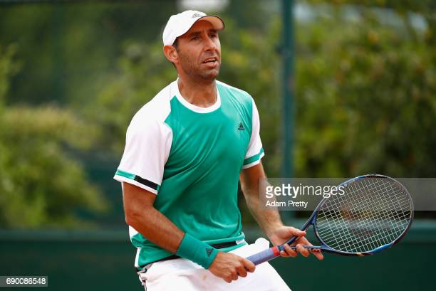 Santiago Gonzalez of Mexico partner of Donald Young of The United States looks on during the mens singles first round match against Daniel Nestor of...