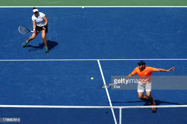 Santiago Gonzalez of Mexico plays a forehand next to his partner Abigail Spears of the United States of America during their mixed doubles final...