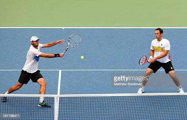 Santiago Gonzalez of Mexico returns a shot next to his partner Scott Lipsky of the United States during their men's doubles third round match against...