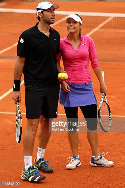 Santiago Gonzalez of Mexico talks tactics with his partner Klaudia JansIgnacik of Poland during their mixed doubles semifinal match against Elena...