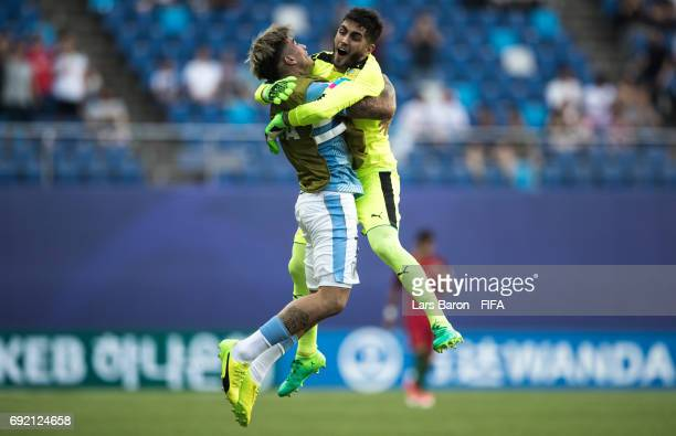 Santiago Mele of Uruguay celebrates with team mate Joaquin Ardaiz of Uruguay after Santiago Bueno of Uruguay scores his teams first goal during the...