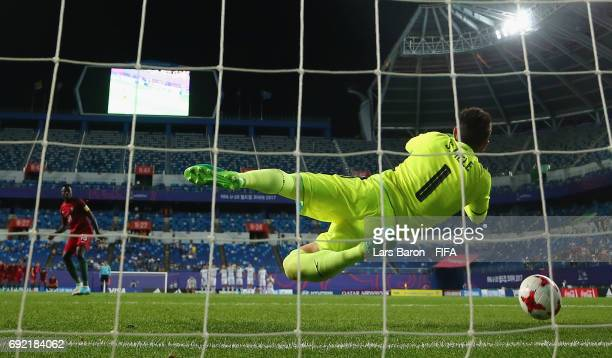 Santiago Mele of Uruguay saves a penalty of Jose Gomes of Portugal during the FIFA U20 World Cup Korea Republic 2017 Quarter Final match between...