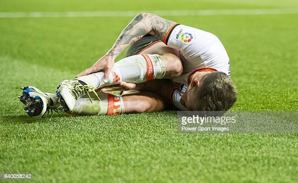 Santiago Mina Lorenzo Santi Mina of Valencia CF lies injured on the pitch during their La Liga match between Villarreal CF and Valencia CF at the...