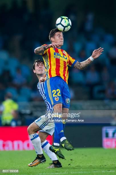 Santiago Mina of Valencia CF duels for the ball with Alvaro Odriozola of Real Sociedad during the La Liga match between Real Sociedad de Futbol and...