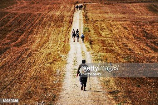 Santiago pilgrims walking on path