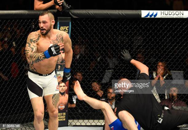 Santiago Ponzinibbio of Argentina celebrates his victory over Gunnar Nelson of Iceland in their welterweight bout during the UFC Fight Night event at...