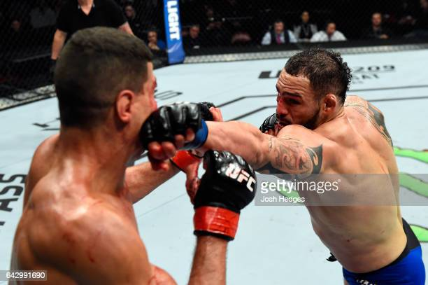 Santiago Ponzinibbio of Argentina punches Nordine Taleb of France in their welterweight fight during the UFC Fight Night event inside the Scotiabank...