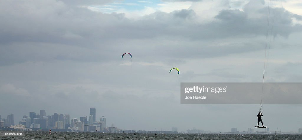 Santiago Porteiro (R) and others take advantage of the winds from the outerbands of Hurricane Sandy to kite surf on October 24, 2012 in Miami, Florida. After passing over Jamaica, Sandy is expected to hit eastern Cuba on Wednesday night and into the Bahamas Thursday and Friday, a tropcial storm warning was issued for east coast of Florida from Ocean Reef to Sebasian Inlet and a tropical storm watch was extended along the east coast to Flagler Beach.