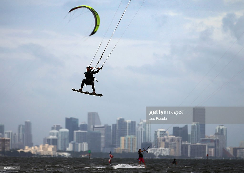 Santiago Porteiro takes advantage of the winds from the outerbands of Hurricane Sandy to kite surf on October 24, 2012 in Miami, Florida. After passing over Jamaica, Sandy is expected to hit eastern Cuba on Wednesday night and into the Bahamas Thursday and Friday, a tropcial storm warning was issued for east coast of Florida from Ocean Reef to Sebasian Inlet and a tropical storm watch was extended along the east coast to Flagler Beach.
