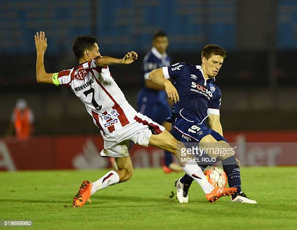 Santiago Romero of Uruguay's Nacional vies for the ball with Bruno Montelongo of Uruguay's River Plate during their Libertadores Cup football match...