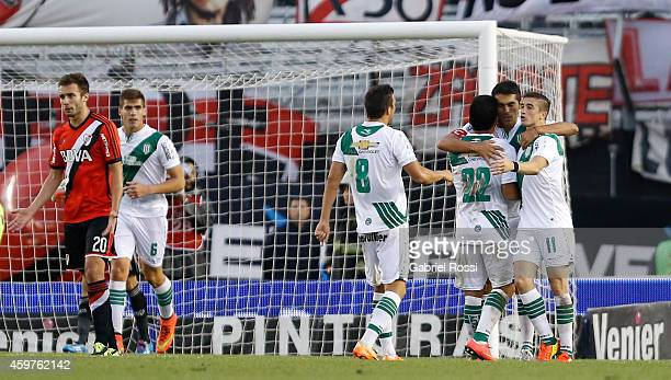 Santiago Salcedo of Banfield celebrates with his teammates after scoring the second goal of his team from the penalty spot during a match between...