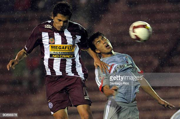 Santiago Salcedo of CA Lanus fights for the ball with Gustavo Cabral of River Plate during a match as part of the Copa Nissan Sudamericana on...
