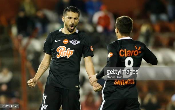 Santiago Salcedo of Libertad celebrates with teammate Juan Danilo Santacruz after scoring the fifth goal of his team during a first leg match between...
