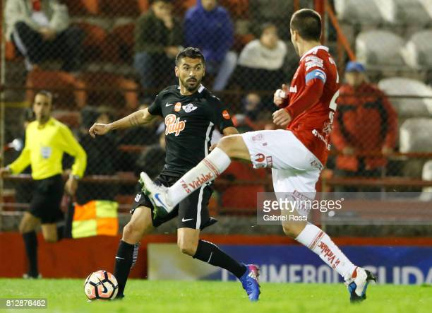 Santiago Salcedo of Libertad fights for the ball with Martin Nervo of Huracan during a first leg match between Huracan and Libertad as part of second...