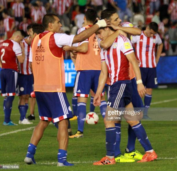 Santiago Salcedo Oscar Romero and Paulo Da Silva of Paraguay look dejected after losing a match between Paraguay and Venezuela as part of FIFA 2018...