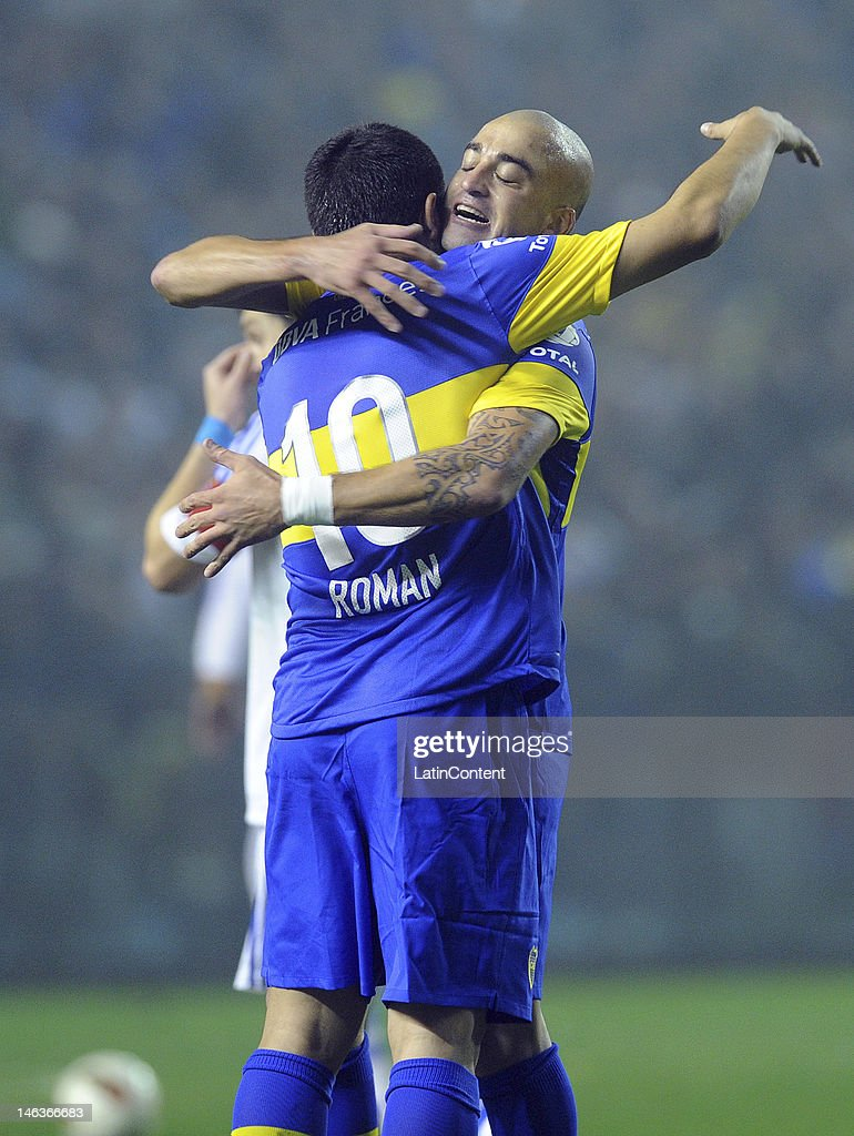 Santiago Silva and <a gi-track='captionPersonalityLinkClicked' href=/galleries/search?phrase=Juan+Roman+Riquelme&family=editorial&specificpeople=243174 ng-click='$event.stopPropagation()'>Juan Roman Riquelme</a> of Boca celebrate the first goal of their team during the first leg of the Copa Libertadores 2012 semi-finals between Boca Jrs and Universidad de Chile at Bombonera Stadium on June 14, 2012 in Buenos Aires, Argentina.