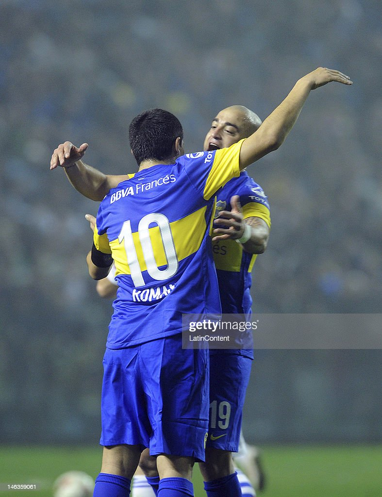 Santiago Silva, from Boca Jrs, celebrate a goal with <a gi-track='captionPersonalityLinkClicked' href=/galleries/search?phrase=Juan+Roman+Riquelme&family=editorial&specificpeople=243174 ng-click='$event.stopPropagation()'>Juan Roman Riquelme</a> during the first leg of the Copa Libertadores 2012 semi-finals between Boca Jrs and Universidad de Chile at Bombonera Stadium on June 14, 2012 in Buenos Aires, Argentina.