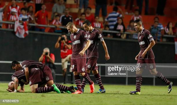 Santiago Silva of Lanus celebrates a scored goal with teammates during a match between Estudiantes and Lanus as part of third round of Torneo Final...