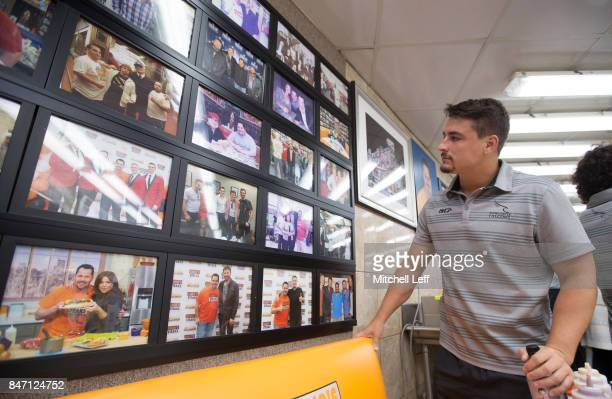 Santiago Socino of the Newcastle Falcons looks at the wall of fame pictures at Geno's Steaks on September 14 2017 in Philadelphia Pennsylvania