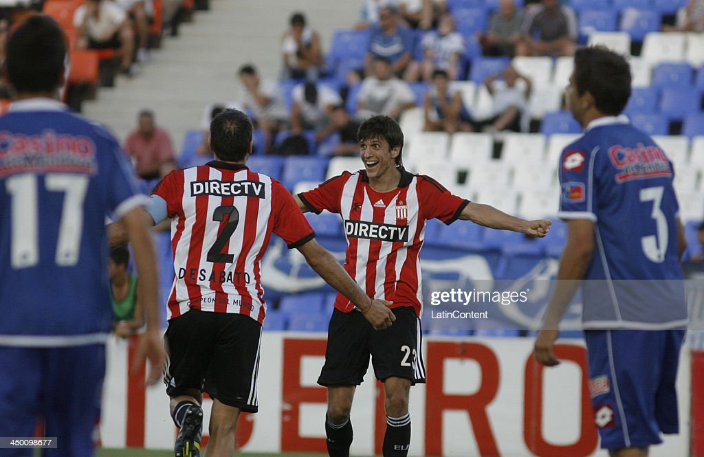 Santiago Vergini and Leandro Desabato celebrate a goal during a match between Godoy Cruz and Estudiantes as part of Torneo Inicial at Mundialista Stadium on November 16, 2013 in Mendoza, Argentina.