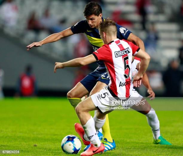 Santiago Vergini of Boca Juniors fights for the ball with Santiago Ascacibar of Estudiantes de La Plata during a match between Estudiantes and Boca...