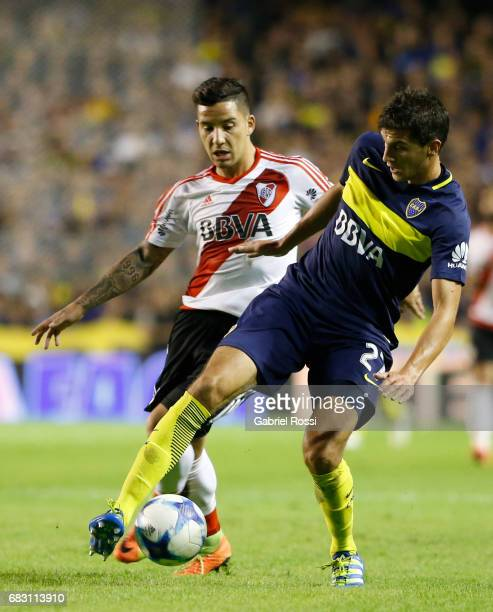 Santiago Vergini of Boca Juniors fights for the ball with Sebastian Driussi of River Plate during a match between Boca Juniors and River Plate as...