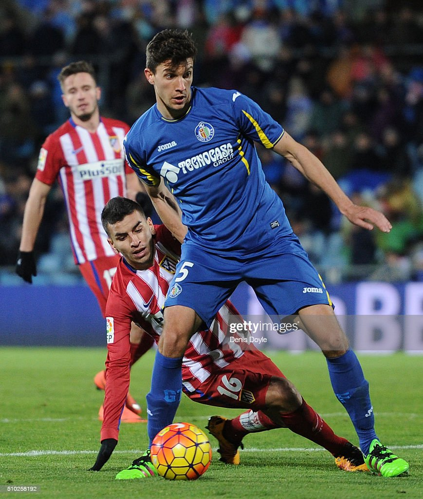 <a gi-track='captionPersonalityLinkClicked' href=/galleries/search?phrase=Santiago+Vergini&family=editorial&specificpeople=9749014 ng-click='$event.stopPropagation()'>Santiago Vergini</a> of Getafe holds off Angel Correa of Club Atletico de Madrid during the La Liga match between Getafe CF and Club Atletico de Madrid at Coliseum Alfonso Perez on February 14, 2016 in Getafe, Spain.