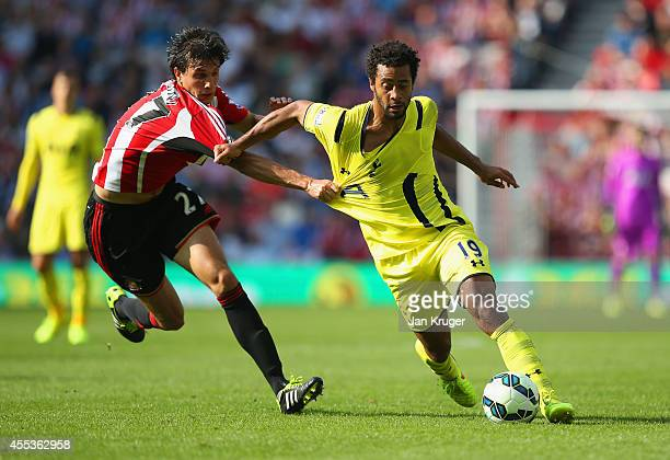 Santiago Vergini of Sunderland pulls on the shirt of Mousa Dembele of Spurs during the Barclays Premier League match between Sunderland and Tottenham...