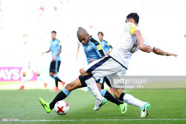 Santiago Viera of Uruguay defends Rolando Mandragora of Italy during the FIFA U20 World Cup Korea Republic 2017 3rd rank playoff match between...