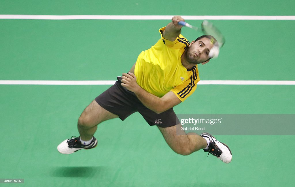 Santiago Zambrano of Ecuador returns the ball to Alberto Raposo of Domincan Republic (not in frame) during the Badminton Men's Single Qualifiers as part of the XVII Bolivarian Games Trujillo 2013 at Coliseo Miguel Grau on November 17, 2013 in Lima, Peru.