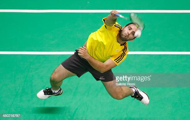 Santiago Zambrano of Ecuador returns the ball to Alberto Raposo of Domincan Republic during the Badminton Men's Single Qualifiers as part of the XVII...