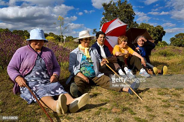 Santiago's Way Jacobean Routes French way A group of women relax sitting on the fields of Santa Colomba de Somoza a village near the Way at the...