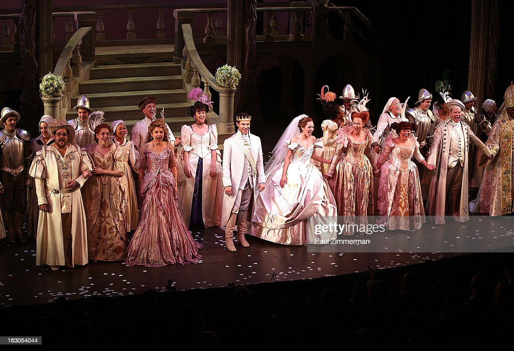 Santino Fontana (CL) and <a gi-track='captionPersonalityLinkClicked' href=/galleries/search?phrase=Laura+Osnes&family=editorial&specificpeople=4213655 ng-click='$event.stopPropagation()'>Laura Osnes</a> (CR) with cast of'Cinderella' Broadway Opening Night curtain call at Broadway Theatre on March 3, 2013 in New York City.