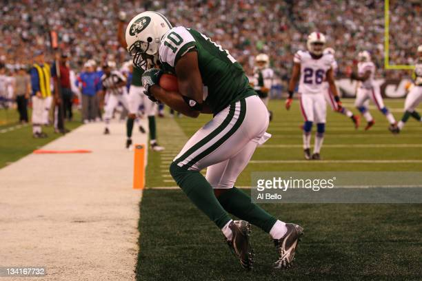 Santonio Holmes of the New York Jets catches the go ahead touchdown against the Buffalo Bills during their game on November 27 2011 at MetLife...