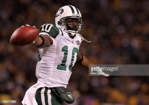 Santonio Holmes of the New York Jets celebrates after he scored a third quarter touchdown against the Pittsburgh Steelers during the 2011 AFC...