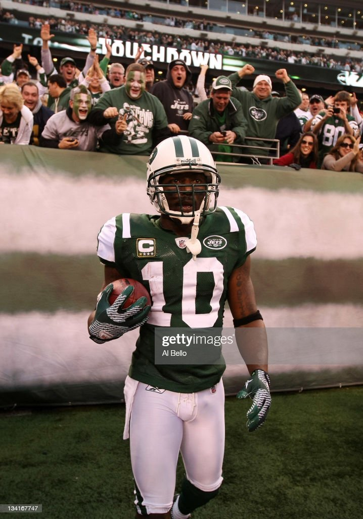 <a gi-track='captionPersonalityLinkClicked' href=/galleries/search?phrase=Santonio+Holmes&family=editorial&specificpeople=618140 ng-click='$event.stopPropagation()'>Santonio Holmes</a> #10 of the New York Jets celebrates his go ahead touchdown against the Buffalo Bills during their game on November 27, 2011 at MetLife Stadium in East Rutherford, New Jersey.