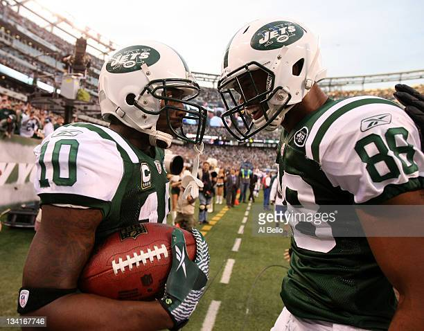 Santonio Holmes of the New York Jets celebrates his go ahead touchdown with Jeff Cumberland against the Buffalo Bills during their game on November...
