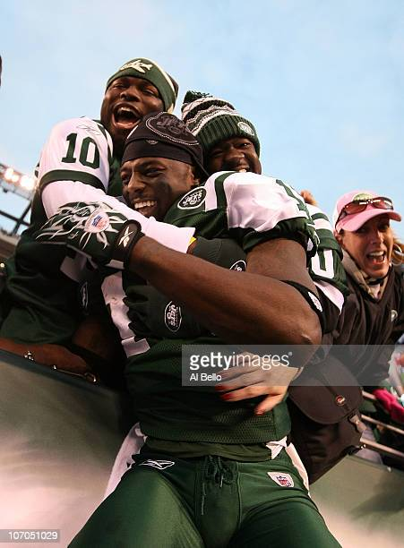 Santonio Holmes of the New York Jets celebrates with fans after scoring the winning touchdown against the Houston Texans during the fourth quarter of...