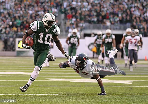 Santonio Holmes of the New York Jets eludes Troy Nolan of the Houston Texans to score a touchdown during the third quarter of their game on November...