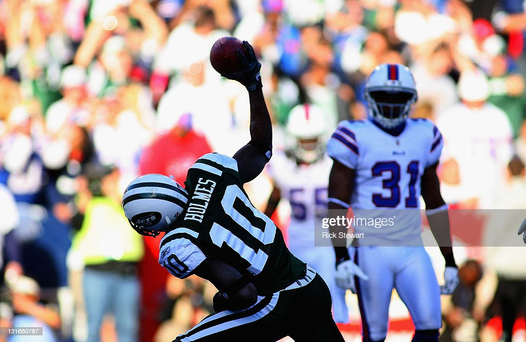 <a gi-track='captionPersonalityLinkClicked' href=/galleries/search?phrase=Santonio+Holmes&family=editorial&specificpeople=618140 ng-click='$event.stopPropagation()'>Santonio Holmes</a> #10 of the New York Jets spikes the ball after scoring a touchdown against the Buffalo Bills at Ralph Wilson Stadium on November 6, 2011 in Orchard Park, New York.New York won 27-11.
