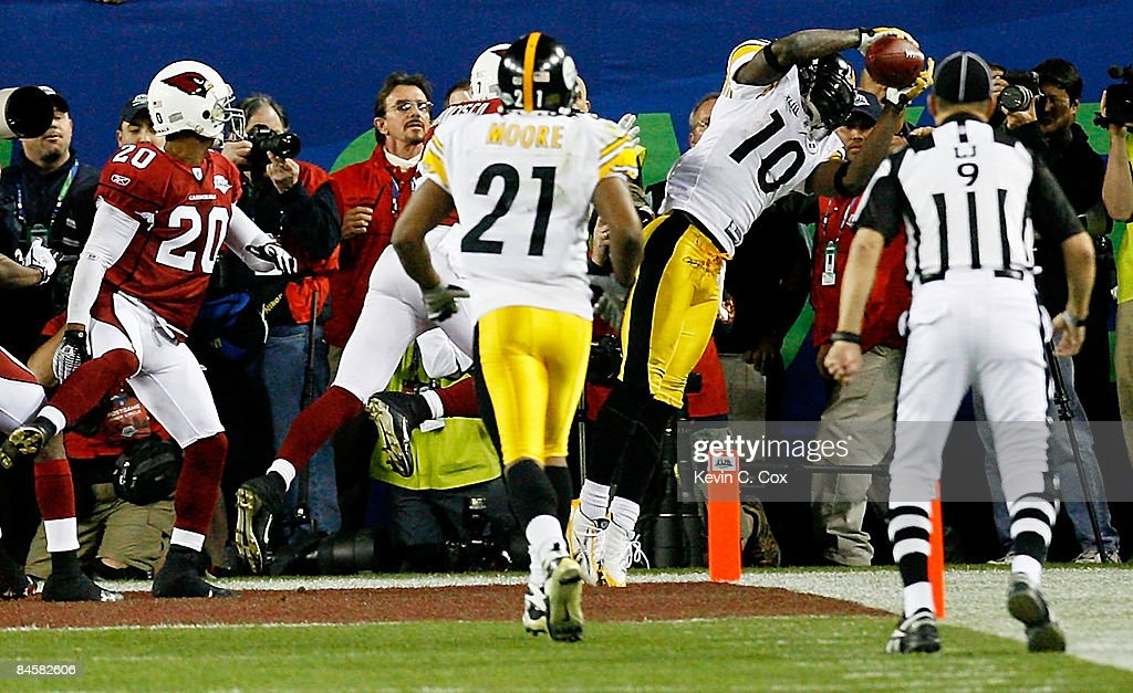 <a gi-track='captionPersonalityLinkClicked' href=/galleries/search?phrase=Santonio+Holmes&family=editorial&specificpeople=618140 ng-click='$event.stopPropagation()'>Santonio Holmes</a> #10 of the Pittsburgh Steelers catches a 6-yard touchdown pass in the fourth quarter against the Arizona Cardinals during Super Bowl XLIII on February 1, 2009 at Raymond James Stadium in Tampa, Florida. The Steelers won the game by a score of 27-23.