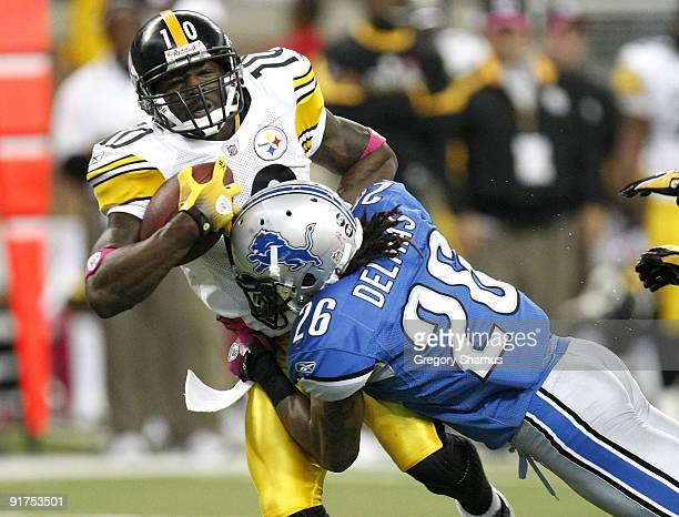 Santonio Holmes of the Pittsburgh Steelers is tackled after making a second quarter catch by Louis Delmas of the Detroit Lions on October 11 2009 at...