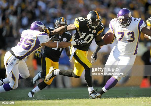Santonio Holmes of the Pittsburgh Steelers runs with the ball as Tyrell Johnson of the Minnesota Vikings defends at Heinz Field on October 25 2009 in...